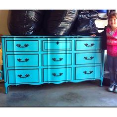 Jenna with her redone dresser.