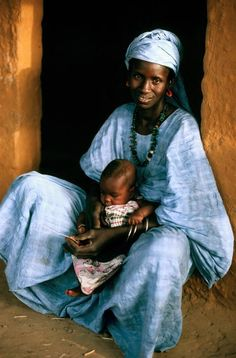 Toucouleur mother and child sitting in a doorway, Senegal.
