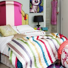 The headboard, the duvet, the pom pom accented sheets - all perfection!  I can so see this for a teen.