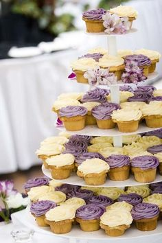 Cupcakes are a fun twist in place of a traditional wedding cake. We are loving these purple hues for Spring! Bride Cupcakes, Wedding Cakes With Cupcakes, Wedding Cakes With Flowers, Flower Cakes, Cupcake Wedding, Pretty Cupcakes, Cupcake Tier, Cupcake Cakes, Cupcake Stands