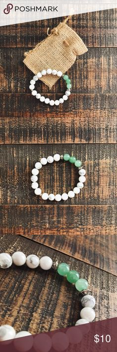 DivinityLA Bracelet this bracelet is super cute and has never been worn! the marbling on the white beads add a little extra character as well as the moons and stars on the silver beads. no trades. DivinityLA Jewelry Bracelets