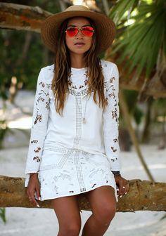 laser cutout mod white shift dress | long sleeves | cutout lace pattern | above-the-knee | paired with a straw fedora and killer tan