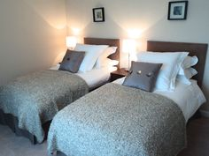 The interior design and renovation brief was to create an environment which would offer bedrooms of hotel quality.  The second bedroom, furnished with high quality twin beds and dressed in fine white bed linen.