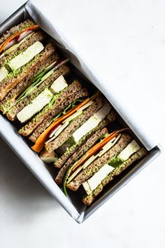 A protein-packed vegan sandwich that features fresh veggies, grilled tofu, sprouted grain bread, and an addictive tahini goddess dressing!