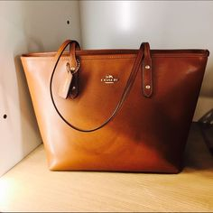 ✨NWT Coach City Zip Tote Another gorgeous addition in to the city zip tote family, this brown spring/summer tote is perfect and functional, exactly what every girl needs on a daily basis! Coach Bags Totes