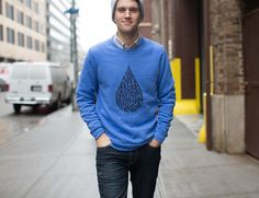 "This cool powder blue sweater isn't just good looking. It'll make you feel like you're being hugged by a gang of puppies as you go about your business. Featuring our slogan, ""Water Changes Everything,"" and made by our pals over at AlternativeApparel/Alternative Earth, this sweater will have you feeling comfy and smiley all day."