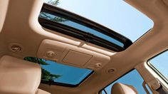 2010 Buick Enclave luxury large crossover SUV with moonroof and fixed rear skylight.