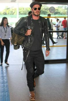 David Beckham looked effortlessly edgy in a Belstaff Weybridge leather biker jacket which he paired with a simple black t-shirt, brown boots, a backpack (which are bang on trend at moment), and his trademark flat cap for a stylish rugged look.