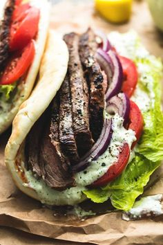 Easy and tasty flank steak gyros with tzatziki cucumber sauce are bursting with hearty flavor. A simple marinade and quick-sear yields super juicy and flavorful beef for the best homemade gyros! Tostadas, Tacos, Enchiladas, Steaks, Chalupa, Beef Marinade, Beef Gyro Meat Recipe, Lamb Gyro Recipe, Marinated Steak