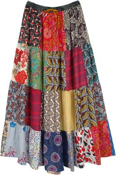 A mixed patchwork cotton skirt with various floral and geometric prints, full maxi length with an elastic waist and drawstring. The elastic waist adds comfort and stretch and drawstring gives you sizing flexibility and a confident fitting. #tlb #Patchwork #MaxiSkirt #Floral #Printed #bohemianfashion #Handmade #PatchworkMaxiSkirt #BohemianSkirt #HippieSkirt #CottonPatchworkSkirt