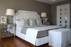 Comfy Bedroom With Square Ottomans And Mirrored Nightstands : Choose A Mirrored Nightstand That Will Glam Up Your Bedroom