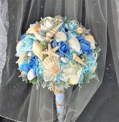 Beach Bride Wedding-Destination Beach-Beach by ModernWeddingTrends wedding flowers Blue Beach Wedding Bridal Flower Bouquet Boho Bridal Beach Flowers Silk Bridal Wedding Bouquet Seashell Wedding Bouquet Starfish Wedding Blue Beach Wedding, Seashell Wedding, Beach Wedding Bouquets, Beach Wedding Reception, Rustic Wedding Flowers, Beach Wedding Decorations, Bridal Flowers, Flower Bouquet Wedding, Arch Wedding