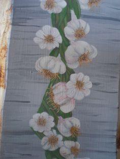 Garlic braid acrylic on wood close up