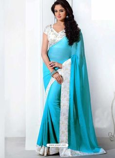 4330513589ffbc Turquoise blue crepe silk casual saree features self-color circular  jacquard buttis spread all over with key pattern prints enhanced wide patch  border ...