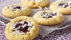 Honorable Mention - Contest Recipe 2008! Bite into a tasty pocket of raspberry jam when you make these sugar cookies sprinkled with white chocolate.