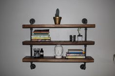Industrial pipe shelf, Pipe shelving, Wood and pipe shelf, Pipe shelf, Industrial shelf, Floating shelf, Reclaimed wood shelf by ReclaimedWoodUSA on Etsy https://www.etsy.com/listing/231240329/industrial-pipe-shelf-pipe-shelving-wood