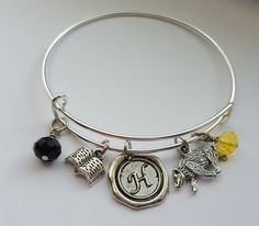 This listing is for one bracelet made with silver plated nickel-free expandable bangle and charms inspired by the Hufflepuff Hogwarts House in