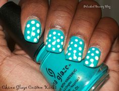 Turquoise nails with white polka dots