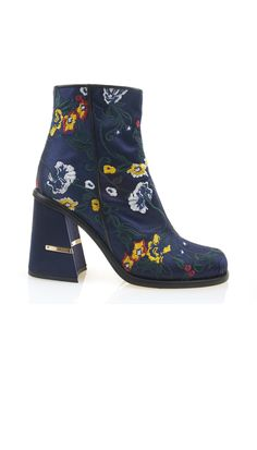 A favorite of the collection, these embroidered satin ankle boots are the seasonal must-have. Wear your on-trend pair with a multitude of looks. 100% Leather, Satin UpperMade in Italy Style Number: SPF16NOR4057Available in: Olive, Plum, Black/White, Navy/Black Multi, Black, Navy