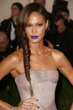 Joan Smalls bucked the trend for classic red carpet hair at the Met Ball with a side swept fishtail plait