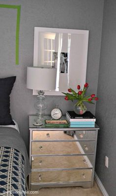 DIY Mirrored Nightstand.. I have been searching a tutorial for mirrored drawers for a long time. I am definitely going to look into making my own..