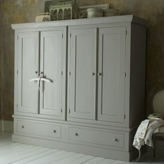 Shaker style wardrobe. Use for linens and extra clothing.