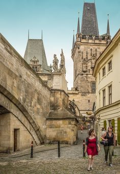 The 15th century Mala Strana Bridge Towers in Prague_ Czech Republic | At the Western end of Charles Bridge, the towers guard the pedestrian entrance to the Lesser Town (Mala Strana)