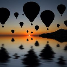 i freakin love hot air balloons. one day i will get to ride in one..