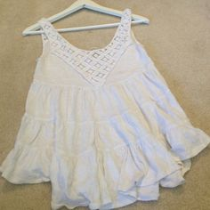 SEE SALE Free People White Layered Top good condition, layered design, lace like straps and pattern on the front, can be worn with shorts and sandals in the summer or jeans a cardigan and boots in the fall or winter, versatile and cute, can also fit size small Free People Tops Blouses