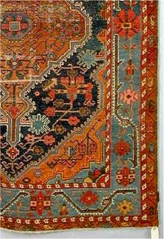 Antique Oriental Persian Rug. Love the age to the weave, and the colors
