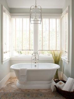 "Transitional Master Bathroom with Master bathroom, Kichler Larkin 12"" Wide Brushed Nickel Foyer Pendant, Freestanding Bathtub"