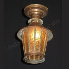 Late 20s solid copper flush mount antique porch light fixture. All glass intact with no cracks. This has a great vintage feel, right at home on the porch.  Drop: 10 1/2 inches  Width: 7 inches http://www.vintagelights.com/product/1/vintage-ceiling-mount-vintage-copper-porch-light.html