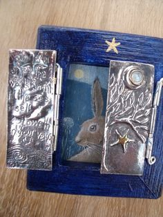 Hare with silver doors on wood  Www.facebook.com/Hannah.willow.artist