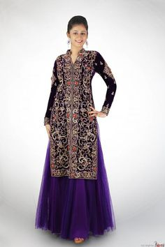 Navy Blue Jacket Style Lehenga Anarkali By : AD Singh Description   Designer lavender lehenga style Anarkali with heavily zari embroidered Jacket. The jacket is made up of shiny velvet with a contrast color net lehenga. This designer Anarkali suit is perfect for functions and wedding and will make you glamorous and yet elegant.