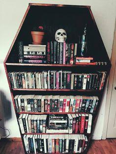 coffin shaped bookshelf