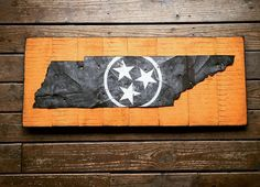 We created our signature Tennessee barn tin sign in a 4' size for one of our favorite teams. Reclaimed wood and 80 year old barn tin with the hand cut state of Tennessee complete this sign with a white distressed Tennessee tristar in the center.