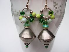 Handcrafted silver Tuareg pearls with green glasspearls hanging on a silver ring and earhooks from 970 Hill Tribe Silver. Expressive earrings, colorful and funny.  Tuareg pearls 0,70´´ length 1,96´´  You can ask to change earwires for all my earrings