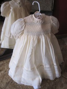 Smocked cream yoke dress. $150.00, via Etsy.  Loved the lace trim on sleeves and hem