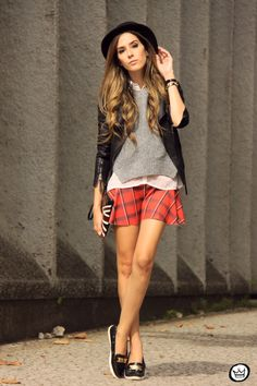 Shop this look for $124:  http://lookastic.com/women/looks/hat-and-biker-jacket-and-crew-neck-sweater-and-button-down-shirt-and-skater-skirt-and-clutch-and-driving-shoes/2033  — Black Hat  — Black Leather Biker Jacket  — Grey Crew-neck Sweater  — White Chiffon Button Down Shirt  — Red Plaid Skater Skirt  — Black Print Leather Clutch  — Black Leather Driving Shoes