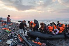 At sunset a group of mostly Syrian refugees arrive on the Greek island of Lesvos after crossing the Aegean Sea from Turkey. <br>©UNHCR/I.Prickett