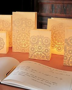 DIY- Give the decorations at a backyard evening dinner party the romantic look of lace. The intricate patterns shining through these luminarias (paper-bag lanterns illuminated by votive candles) are courtesy of doilies glued inside. Doilies Crafts, Paper Doilies, Paper Bag Lanterns, Table Lanterns, Floating Lanterns, Battery Operated Tea Lights, Battery Lights, Do It Yourself Inspiration, Paper Crafts