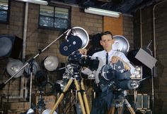 Photographer Ed Westcott took almost all of the photos above. He was the first AEC government photographer in Oak Ridge, and the only authorized photographer during the Manhattan Project. Here, Ed poses with his motion picture cameras and lights in Building 2714 in in Oak Ridge, in 1960. Born in 1922, Westcott still resides in Oak Ridge, and recently celebrated is 90th birthday. (Ed Westcott/DOE) #