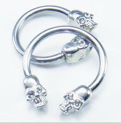 316L Surgical Steel Septum Horseshoe W/ Skull Head Beads                                                                                                                                                      More