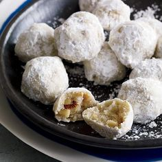 Walnut Snowball Cookies | These buttery, crumbly, sugar-dusted cookies are irresistible. Jerusalem cooks personalize them with different nuts and aromatic flavorings, like rose water or cardamom.