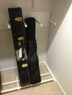 How to organize Steve's 20 guitars. i could make this with a shoe rack, pool noodles, and a cheap coat rack! guitar case storage in closet Guitar Storage, Guitar Display, Guitar Rack, Guitar Hooks, Guitar Stand, Closet Storage, Storage Rack, Ukulele, Home Studio Musik