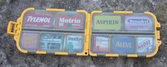 Using a fly-fishing box to store pills in a larger first aid kit.