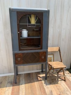 Vintage art deco china cabinet. Distressed gray with stained drawer and door. Storage