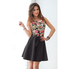 Uitlopende jurk met een bloemen patroon en brede, zwarte lint