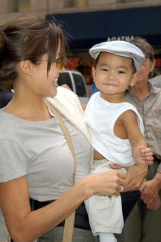 Maddox Jolie-Pitt, 2002 ~ Angelina Jolie adopts baby Maddox in 2002. Here they step out in N.Y.C.