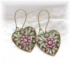 Vintage Style Filigree Heart Earrings, Pink Crystal Heart Dangles Earrings, Brass Earrings Hearts Pink Rhinestones, Kidney Hoop Earrings Pretty Bling Heart Charm Earrings~Filigree brass hearts made in the USA~Nickel Lead Free Hoops and Findings~Swarovski Crystal Accents~Pink Color Shown  Hearts~1H x 7/8W   Thank you for stopping by!  Please see my earrings in my Etsy Shop here: https://www.etsy.com/shop/TheVintageHeart?section_id=7462085&ref=shopsection_...